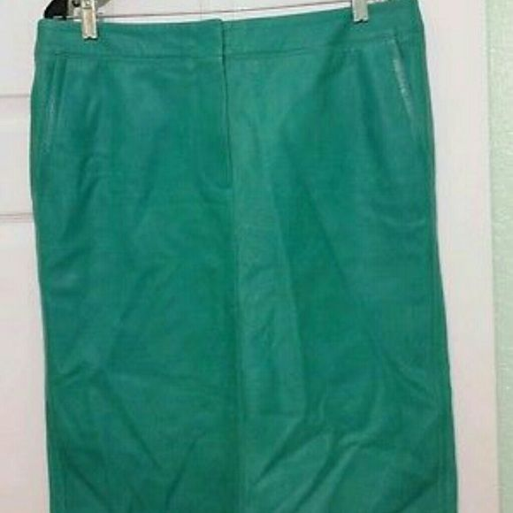 Max Mara Mint green Leather Skirt Sz 46 Skirt is designed with front zippered closure, 2 front side pockets and 2 back pockets and back slit. Interior is lined. Leather is very soft. Measures side to side 18, waistband to hem 24.5. NWOT Beautiful Mint green color nice for all seasons. Willing to trade and reasonable offers Max Mara Skirts