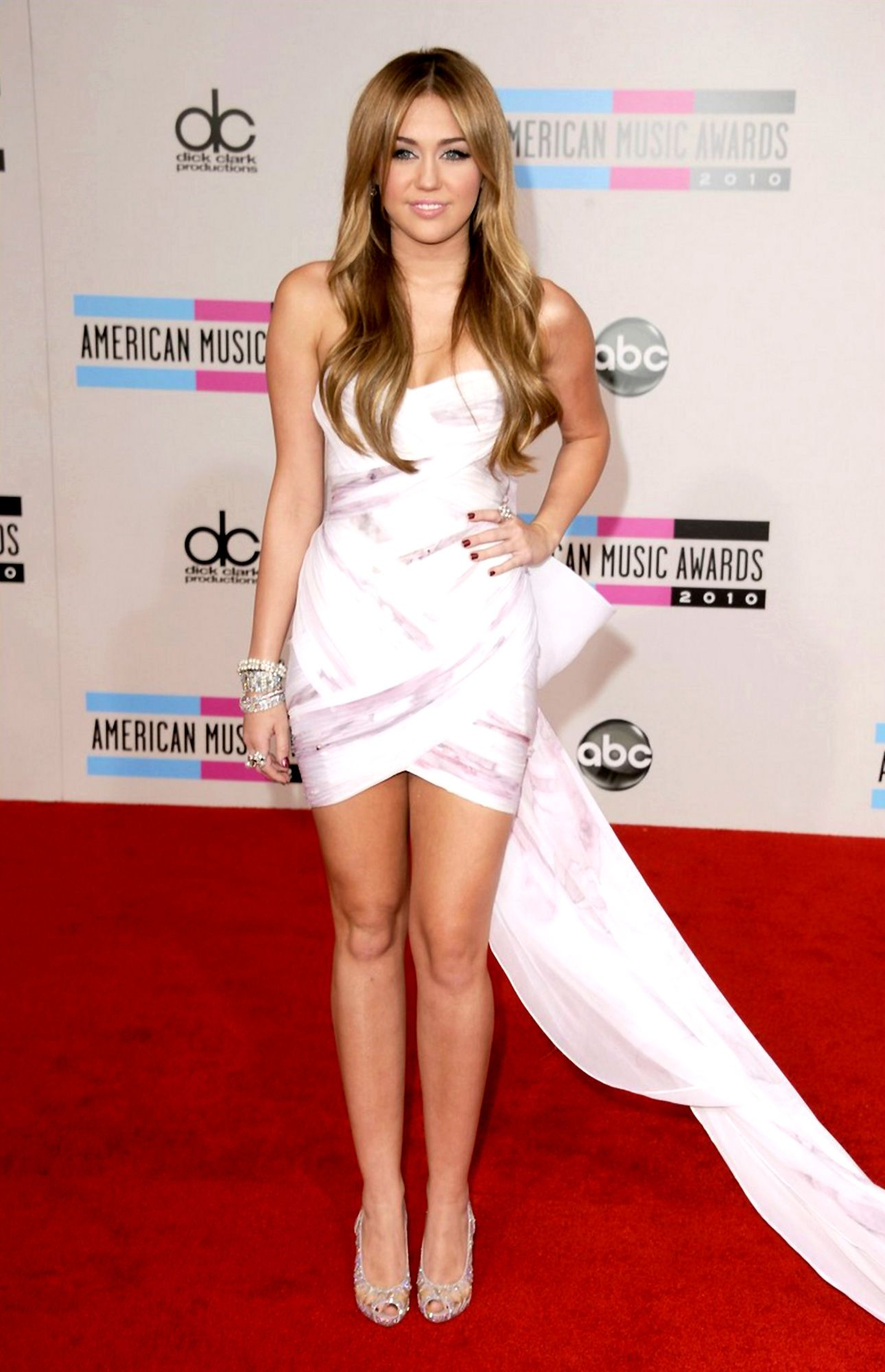 Miley Cyrus in a white dress, showing some leg. | Miley Cyrus ...