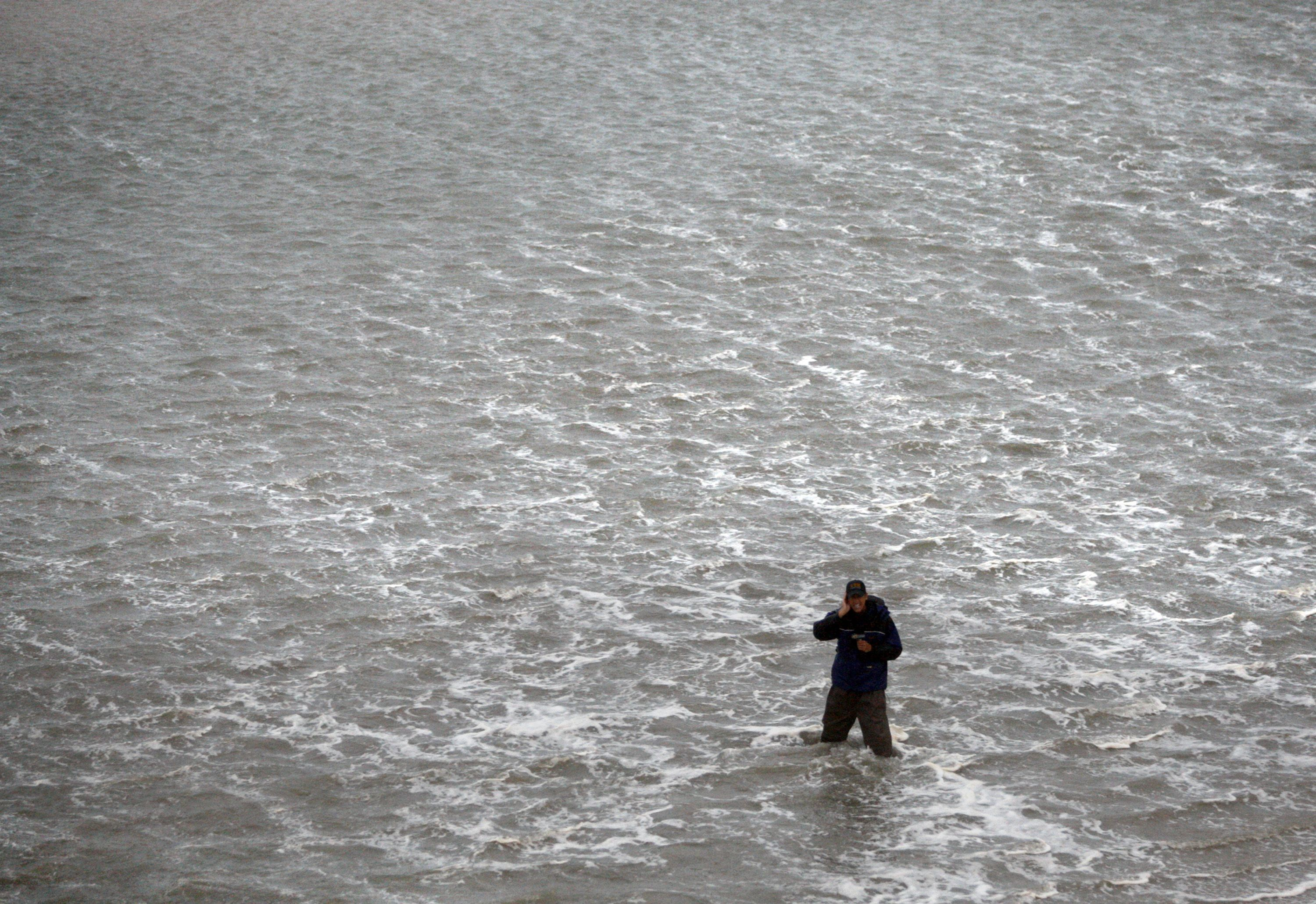 A Television Reporter Stands In The Waves Where A Beach Once Was Outside The Comfort Inn South In Nags Head North Caroli Photojournalism Hurricane Irene Photo