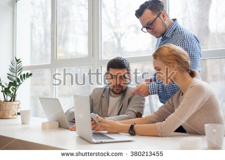 Team Of Three Coworkers In Stylish Studio  Stock Photo  Hubdoc