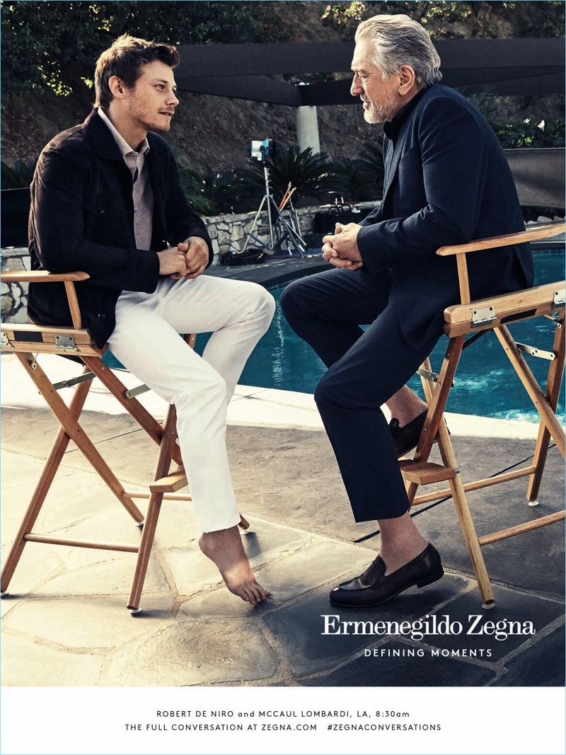 Actors McCaul Lombardi and Robert De Niro enjoy a chat poolside for Ermenegildo  Zegna s Defining Moments campaign. 25983b56eb0
