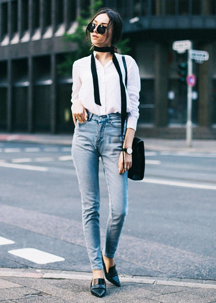 A skinny ribbon scarf is worn with a white blouse, light-wash denim and loafers.  @andwhatelse