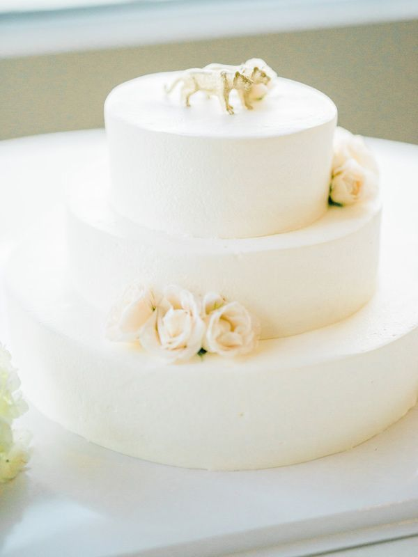 classic wedding cake - photo by Honey Honey Photography http://ruffledblog.com/stylish-pacific-palisades-beach-wedding