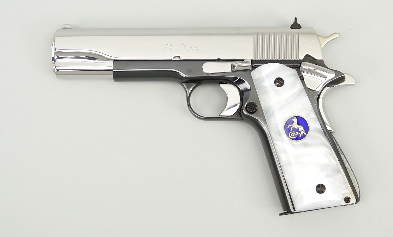 """Colt Government """"El Rey"""" .38 Super caliber pistol. """"El Rey"""" Special Edition with high polish 2-tone finish and fancy grips. A rare Limited Edition model, part of the """"El"""" series from the 1990's. Has been refinished, looks good. Price: $2,250.00 Item Number: C12119"""