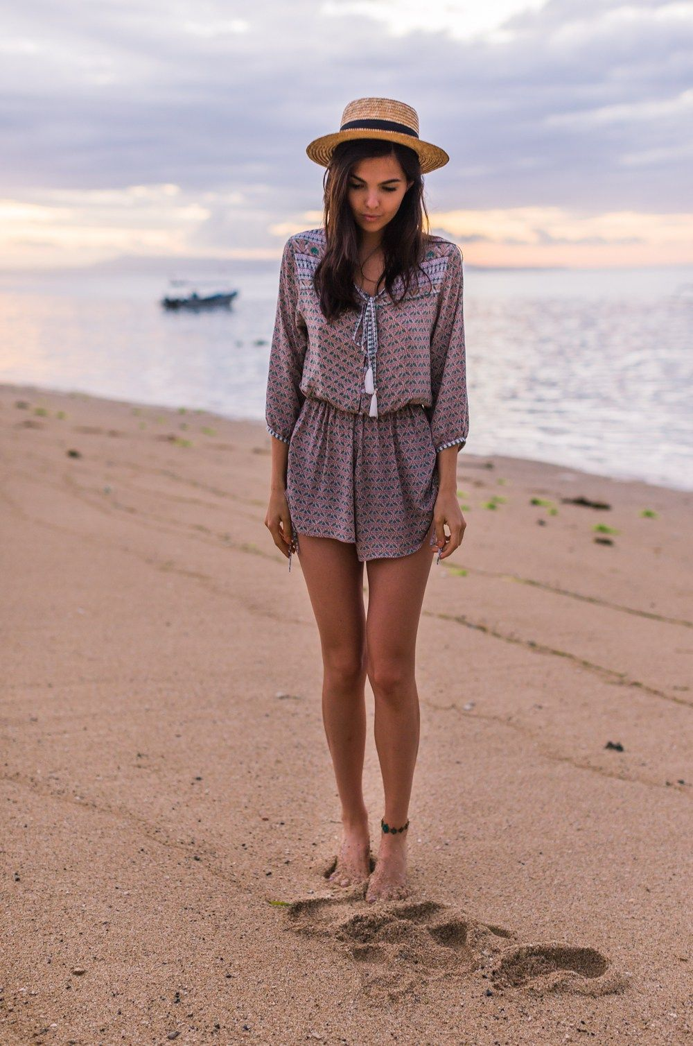 For a cute beach outfit idea, try wearing a loose and light patterned  playsuit with - Outfits For The Beach: It's Gotta Be Cute - Beach Outfit Ideas