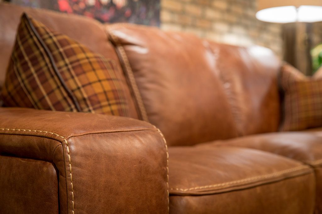 No Detail Is Missed With This Butter Soft Leather Sofa With Contrast  Baseball Stitching.