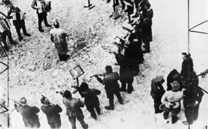 Concentration camp orchestra; This photograph shows an orchestra formed from prisoners at Janowska concentration camp near Lvov being forced to play at the execution of a group of Russian prisoners. In the bottom-right-hand corner of the photograph is Hauptsturmfuhrer Warzock, the camp commandant. Janowska was a forced labour camp for Jews and also a transit camp for Polish Jews being sent to extermination camps.