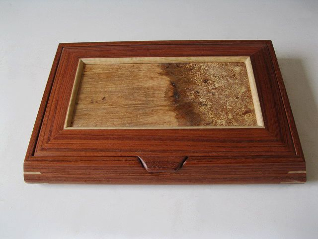 This wooden jewelry box has a lid that lifts to reveal trays with this wooden jewelry box has a lid that lifts to reveal trays with various dividers solutioingenieria Images