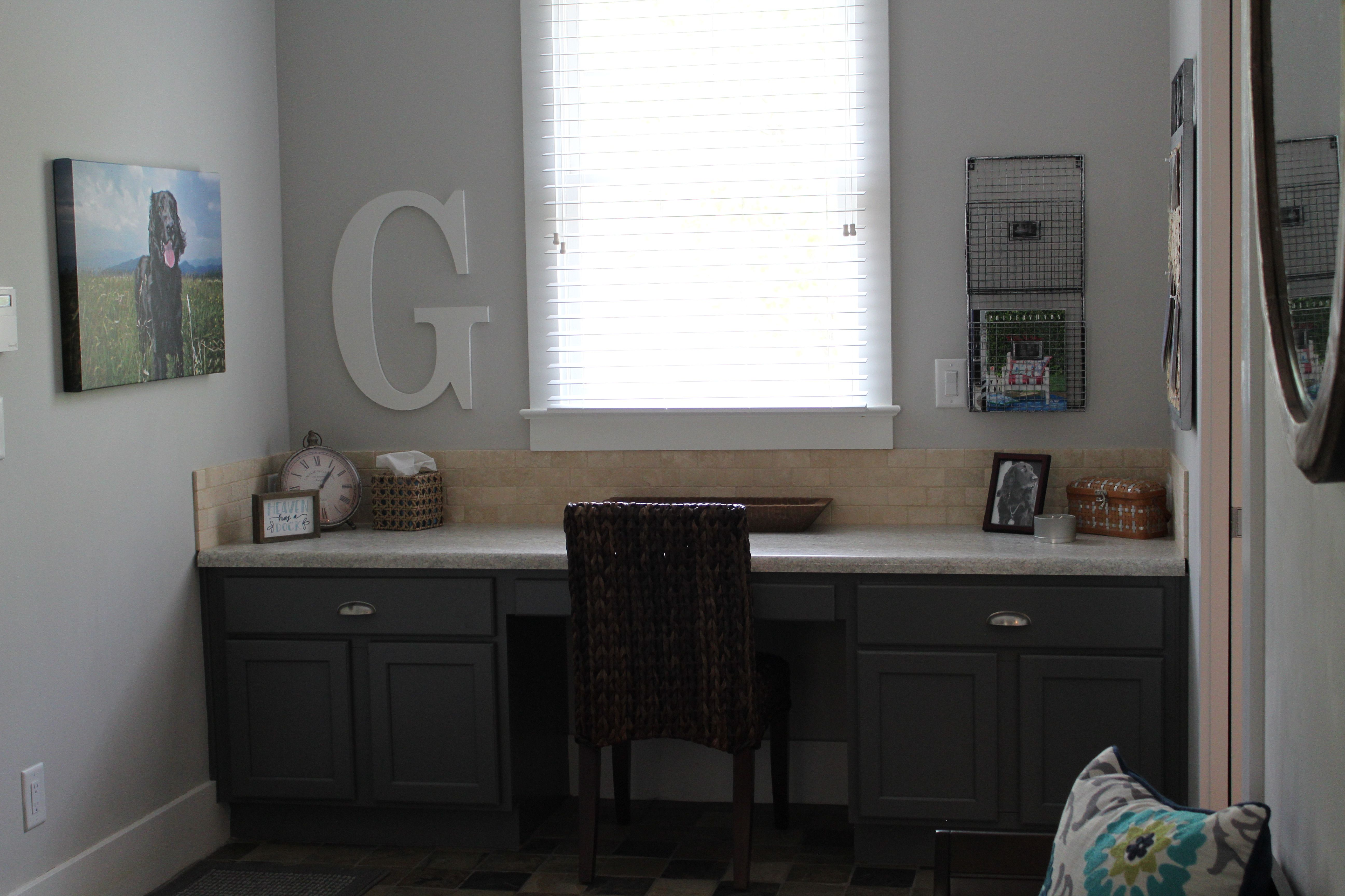 A Built In Desk With Gray Cabinetry And A Granite Top Built In Desk Built In Shelves Cabinetry