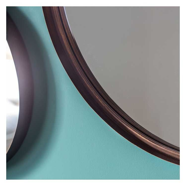 This reading round bronze mirror is exuding with style and charm. It may be smaller in size but that certainly doesn't mean it compromises in style. Its chic bronze frame is bang on trend and would look at home in any contemporary setting. As photographed this mirror creates a striking