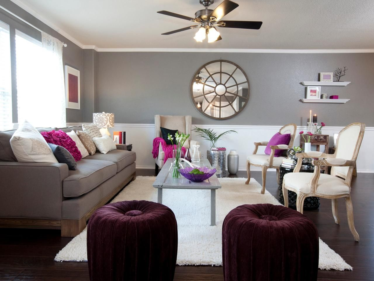 A rich shade of gray gets a pop of color from magenta and Purple living room