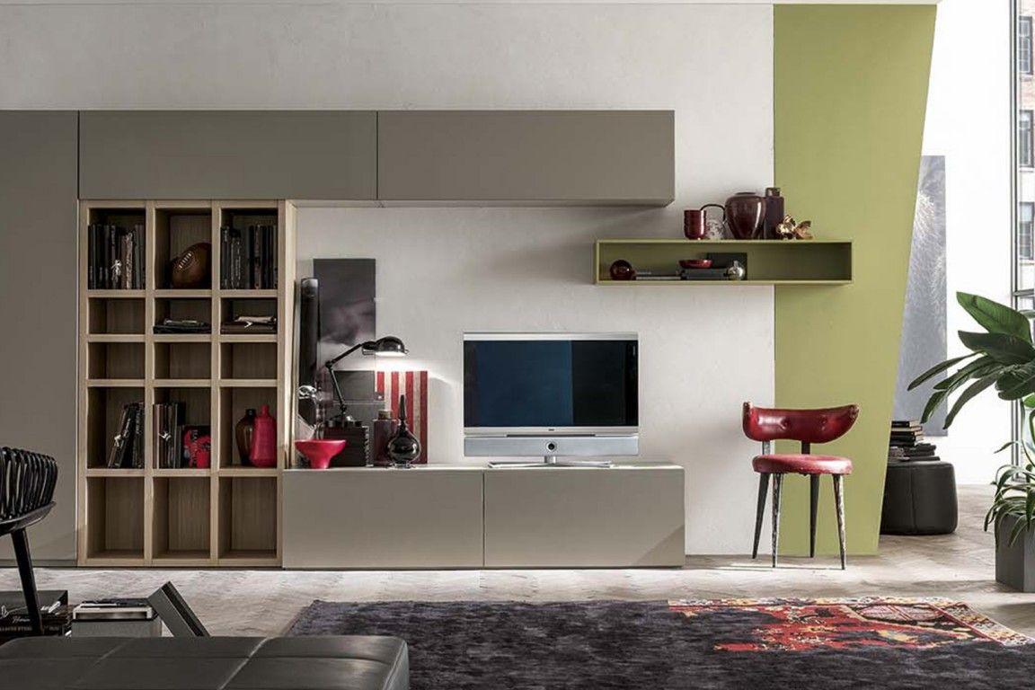 Photo of Divano moderno con parete attrezzata. #arredamentimeneghello #soggiorno #mobilis…