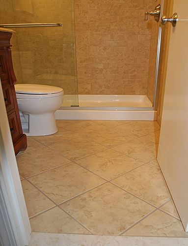 tile on the diagonal on floor contrasted with smaller tiles placed straight on the shower wall small bathroom - Tile Bathroom Designs
