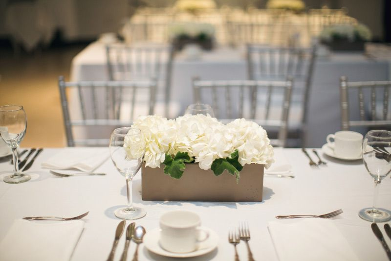 Sleek Sophisticated Wedding Centerpiece For Rectangular Tables Of White Hy White Floral Centerpieces Wedding Table Decorations Diy White Hydrangea Centerpieces
