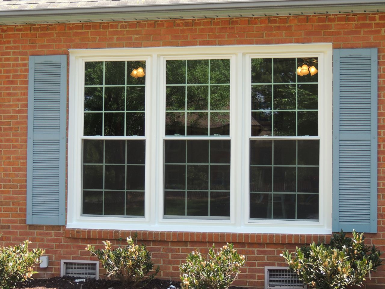 The Old Windows Were Painted Blue And Covered With Brown