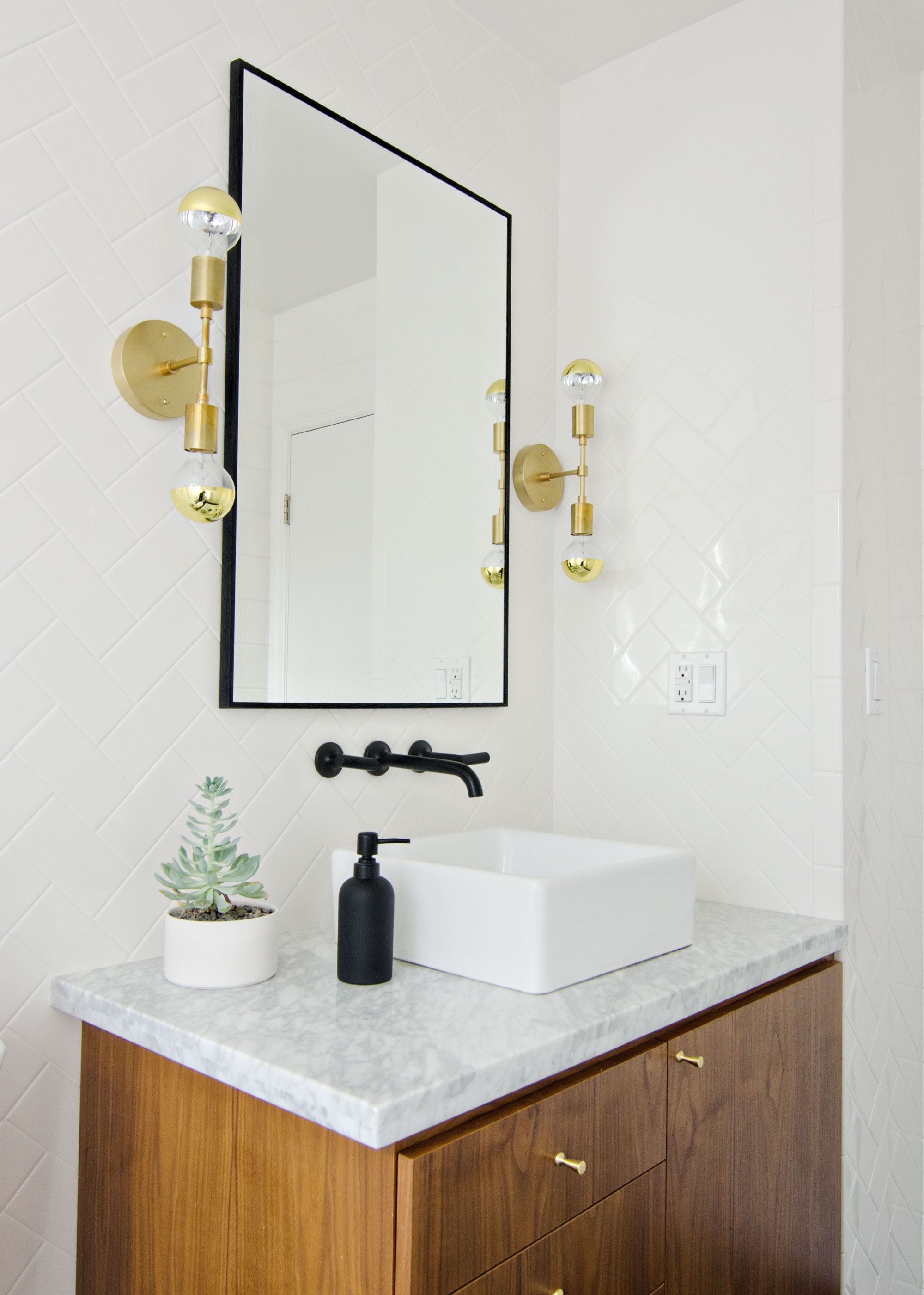 Black, white & walnut bathroom with black faucet & brass sconces ...