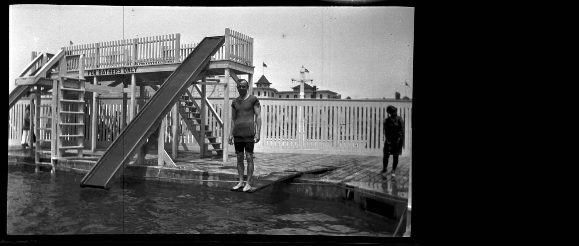 """Summer of 1910.  Man on diving board at swimming pool labeled """"For Bathers Only"""".  From Mr. R.O. Cannons Family Album.  9015 #14426.  Delaware Public Archives.  www.archives.delaware.gov"""