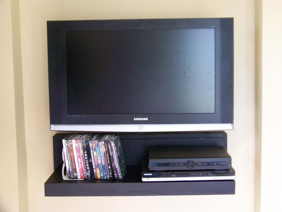Floating AV component shelf LCD/Flat TV stand in by Othacity