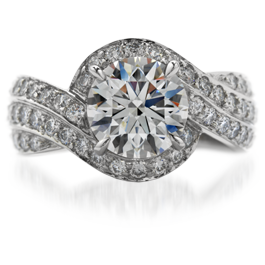 Flowing Ribbons of Diamonds Ascend toward a Regal Hearts on Fire Diamond in this Gorgeous Engagement Ring set in Platinum!