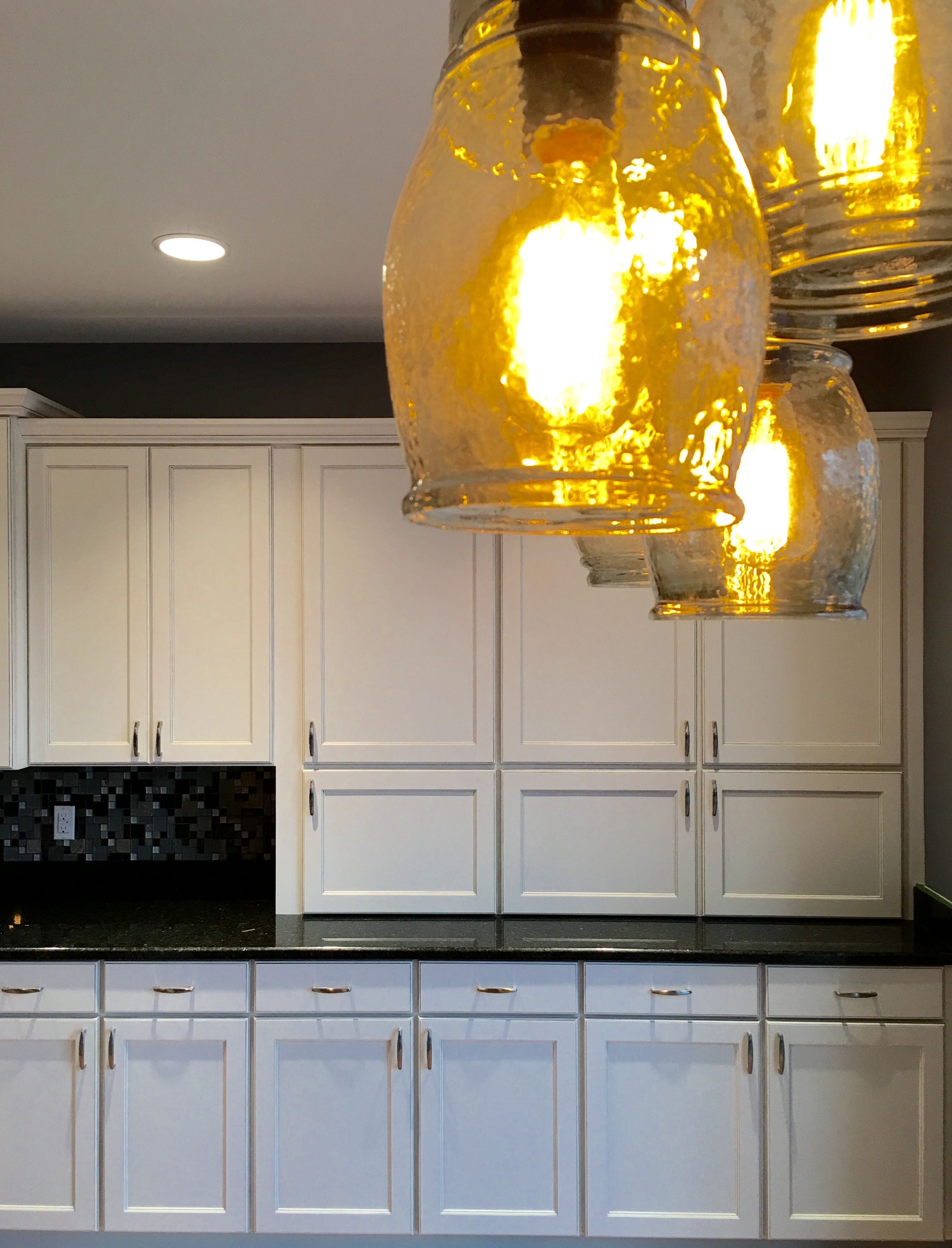 White painted shaker cabinets by MidContinent Cabinetry. These have ...