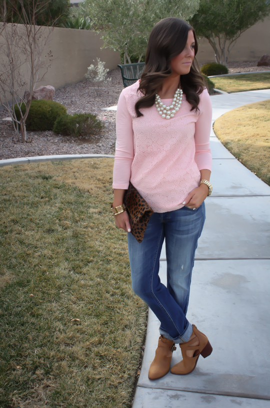 pink sweater and light skinny jeans