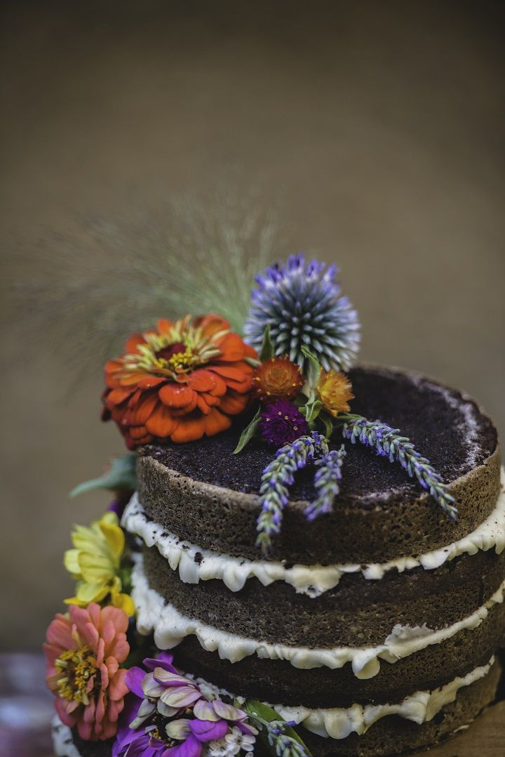 Naked wedding cake decorated with colourful flowers | fabmood.com #bohemianwedding #weddingcake
