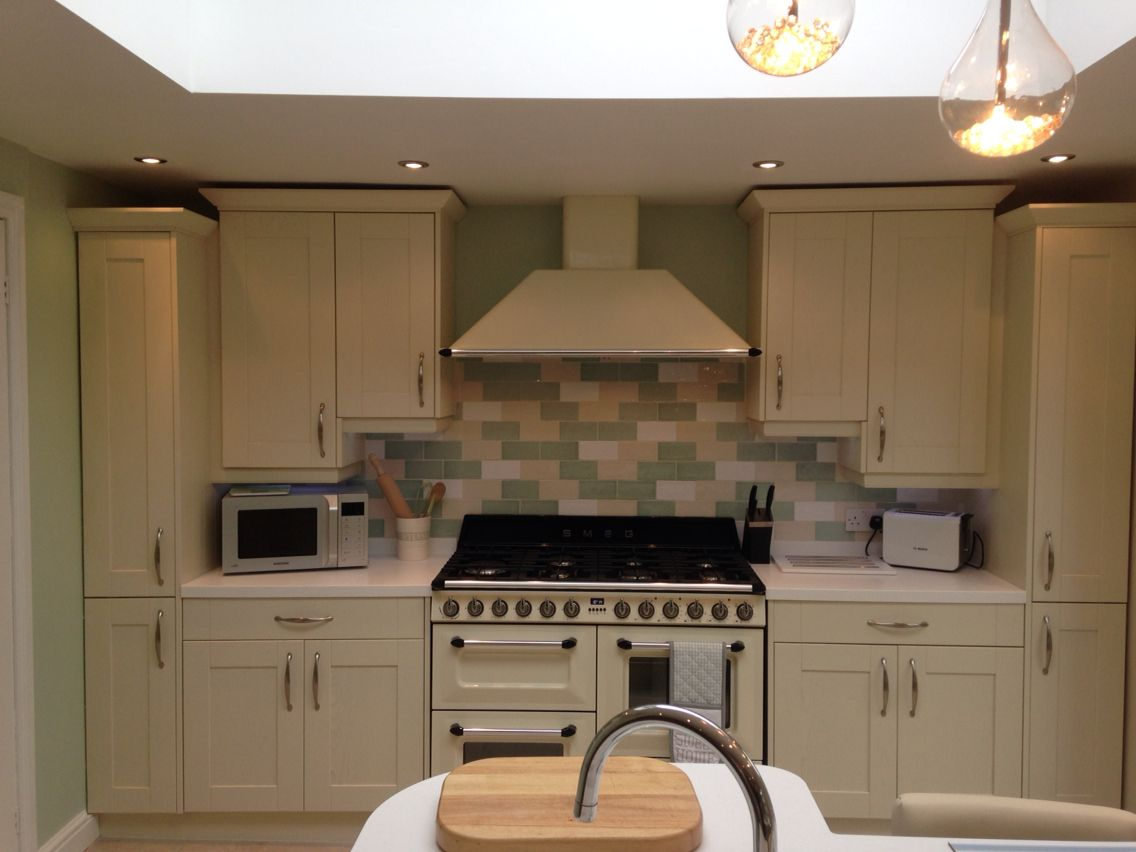 Best Alaska Cream Wren Shaker Kitchen With Corian Work Tops 400 x 300