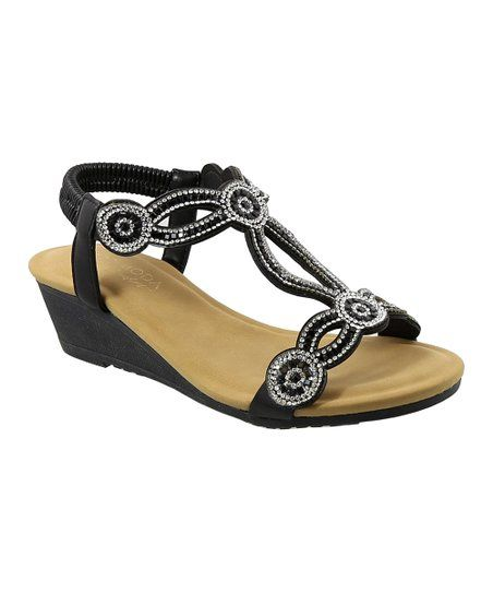 32faa13ab Glitz and glamour abounds in this strappy pair punctuated by rhinestone  accents. An elastic strap