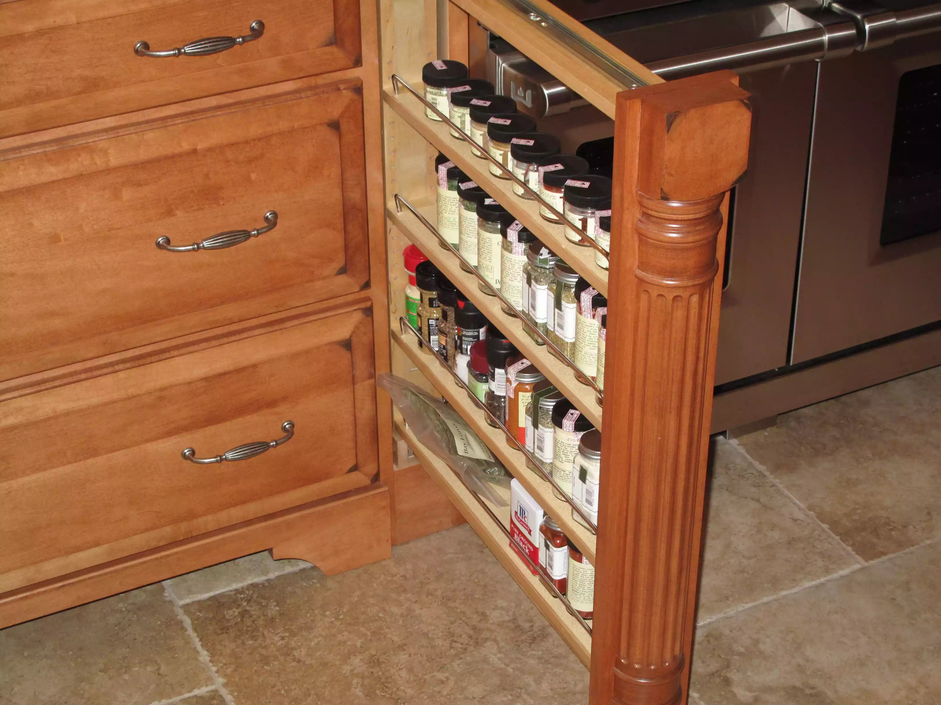 Stained pull out spice rack with column detailing