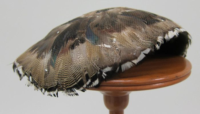 Hatlet with brown, beige, white, blue and green feathers, the whole covered with a very fine veil sprinkled with tiny rhinestones   Designer: Benjamin B. Green-Field (Bes-Ben)   United States, 1955   University of North Texas