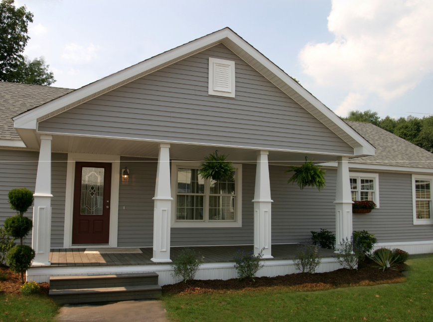 Covered portico porch deck added to the front of a long for Ranch style home kits