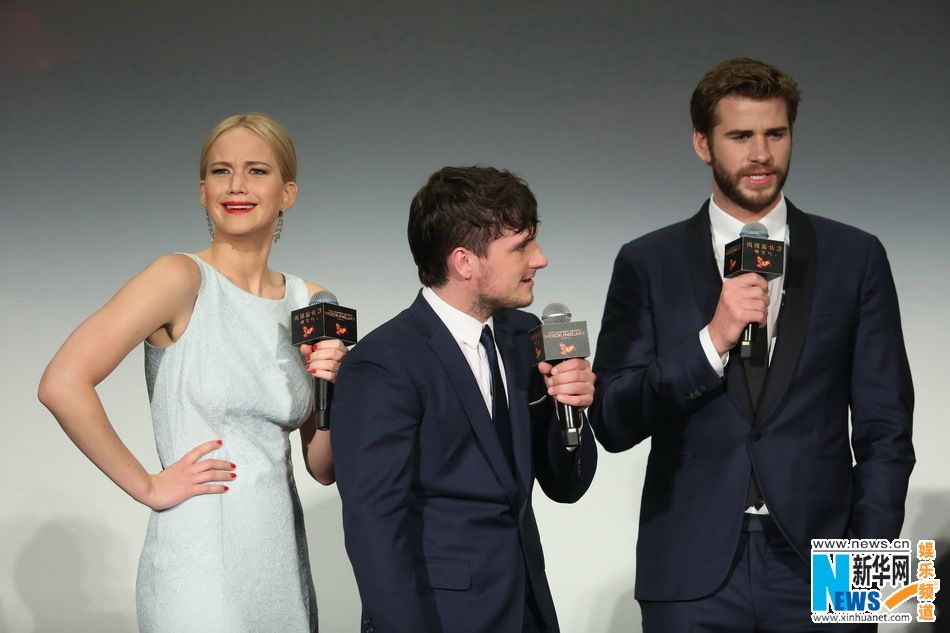 "Actress Jennifer Lawrence, with actors Josh Hutcherson and Liam Hemsworth, poses on the red carpet at the Chinese premiere of ""The Hunger Games: Mockingjay – Part 2"" in Beijing on Nov. 13, 2015. The film will open in China on Nov. 20.   http://www.chinaentertainmentnews.com/2015/11/the-hunger-games-finale-premieres-in.html"