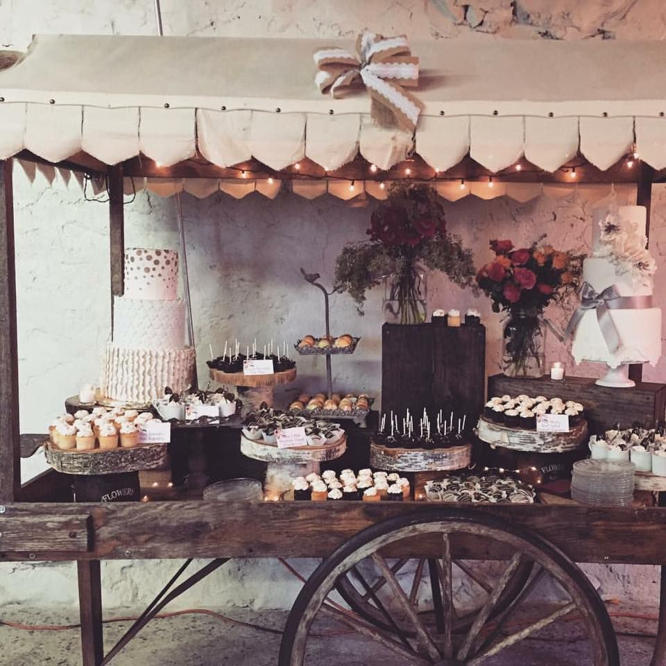 desserts galore uniquely displayed on a rustic style cart barn