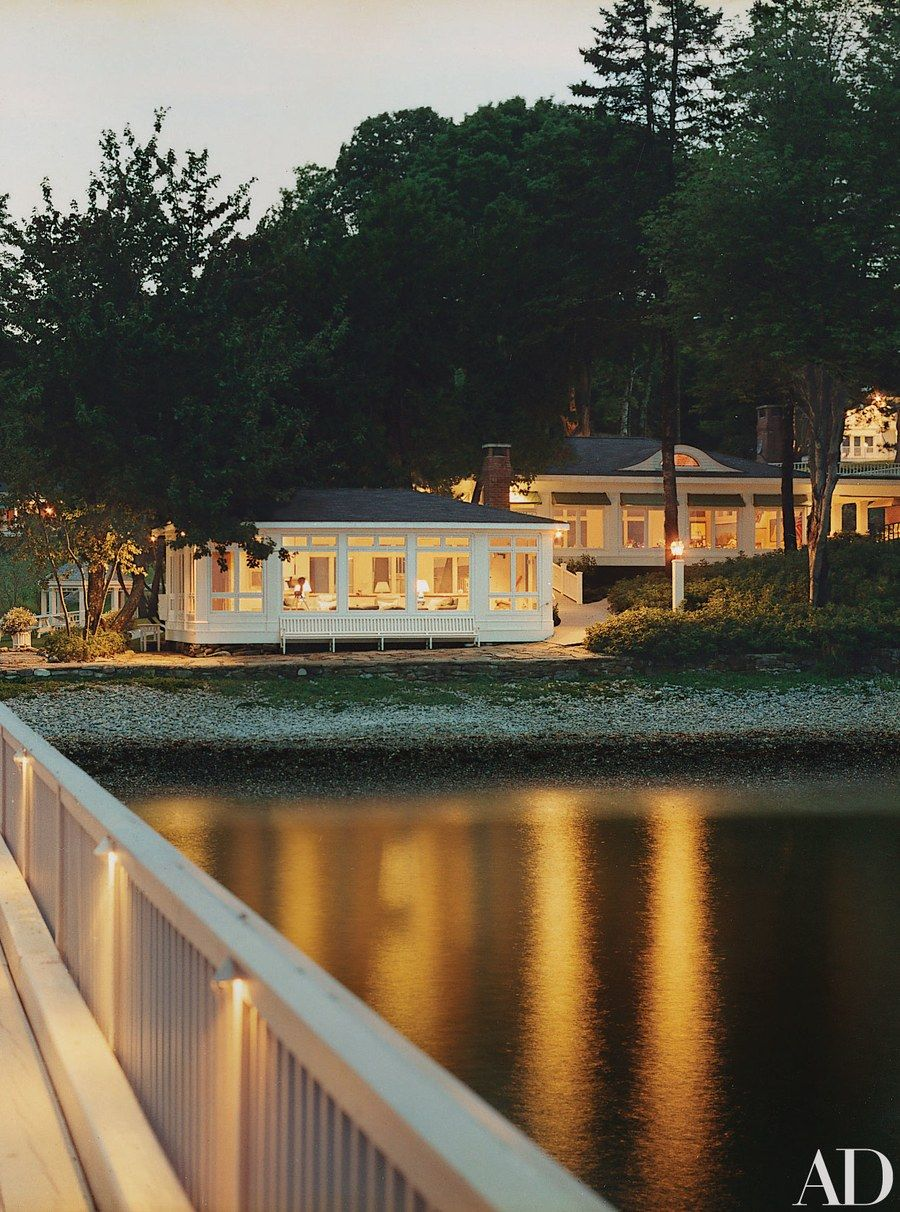 Homeowners in Maine acquired a neighboring waterfront residence that is now used as an eight-bedroom guesthouse. The ten-acre site includes a recently renovated 100-year-old beach house, center, a gathering hall, right, a tennis court, and one other guesthouse.