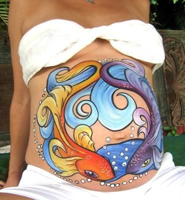 Belly Art: Lake Worth, Florida, USA Award winning and internationally known artist Georgette Pressler provides professional fine art body painting for night clubs,