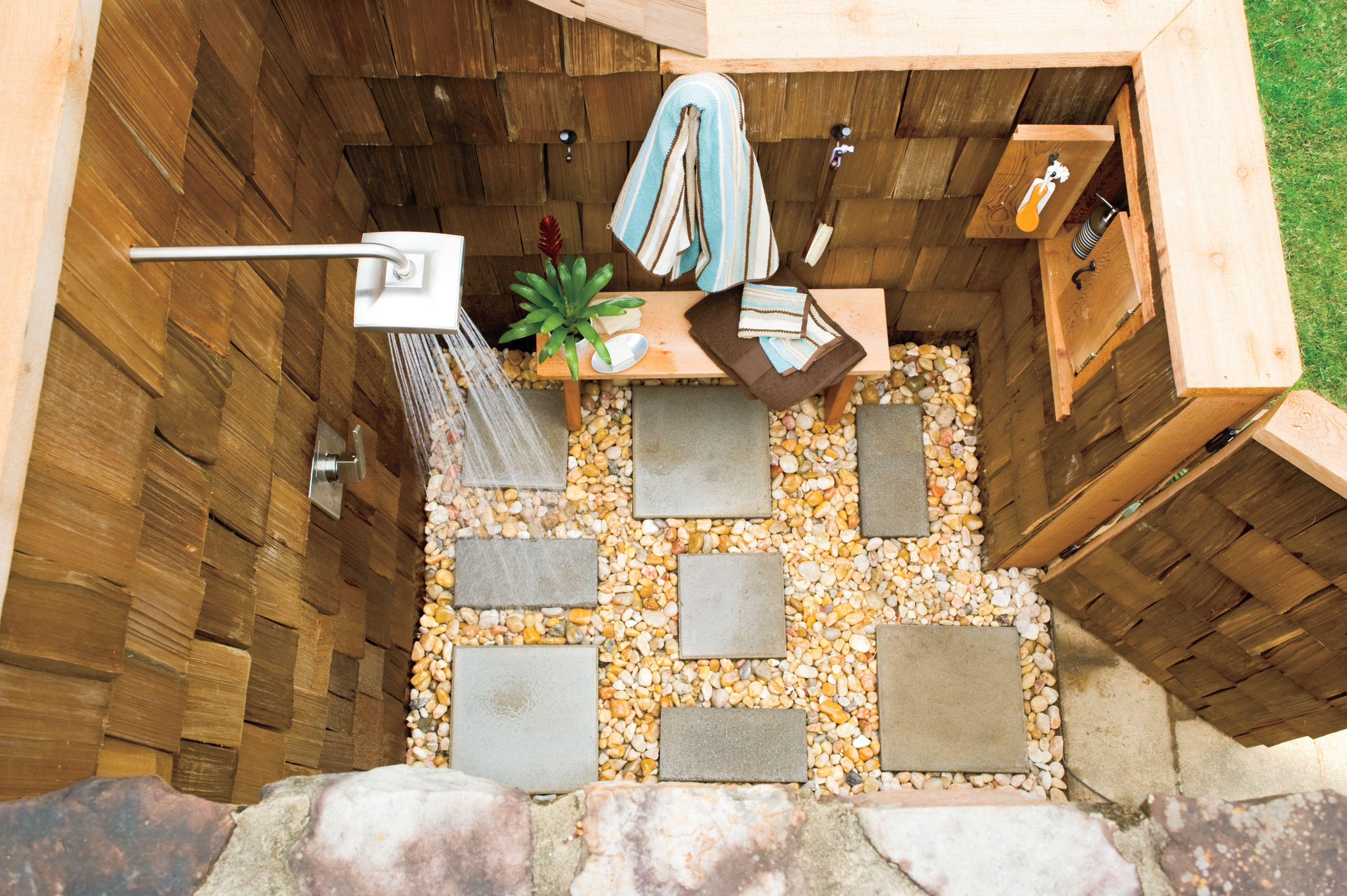 outdoor shower. Really like the stone/pebble floor and enclosure.