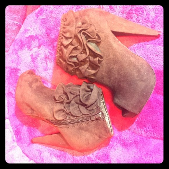 Brown Booties Suede booties with ruffles. Pairs great with skirts, leggings, and jeans. Never worn and still in box. Shoes