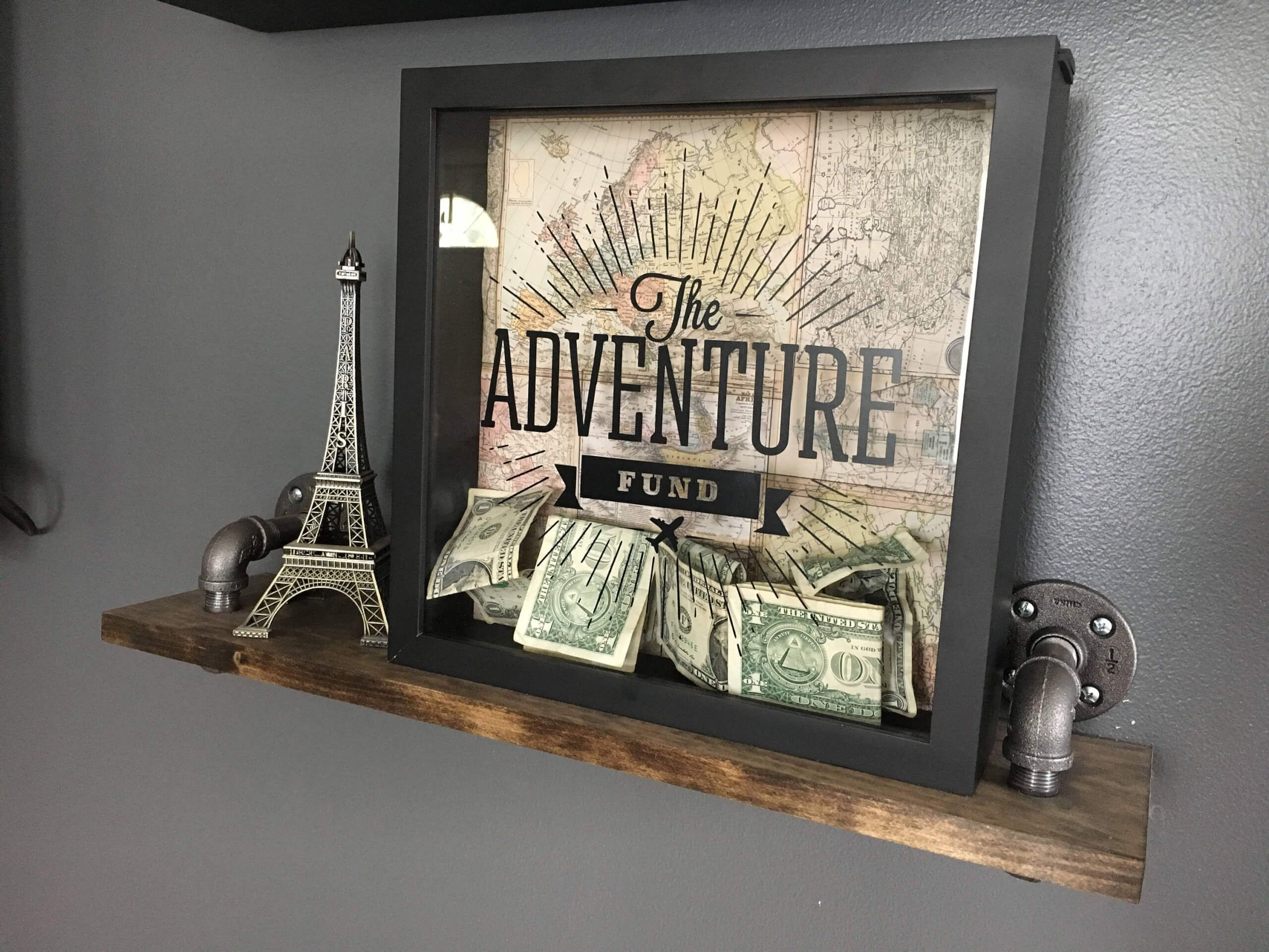 Here S How To Turn Your Vacation Souvenirs Into Travel Themed Home Decor Diy Shadow Box Travel Shadow Boxes Shadow Box