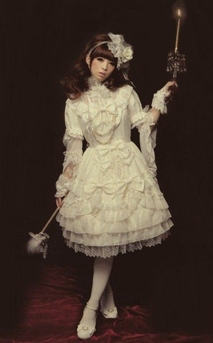 Elegant. So much white lace and bows. Girly and kind of creepy.