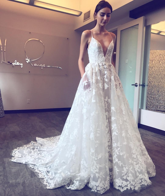 Long wedding dress champagne wedding dress lace appliques v neck sleeveless lace wedding dress with pocketssexy bridal dress with sweep trainbeach wedding dresses ombrellifo Choice Image