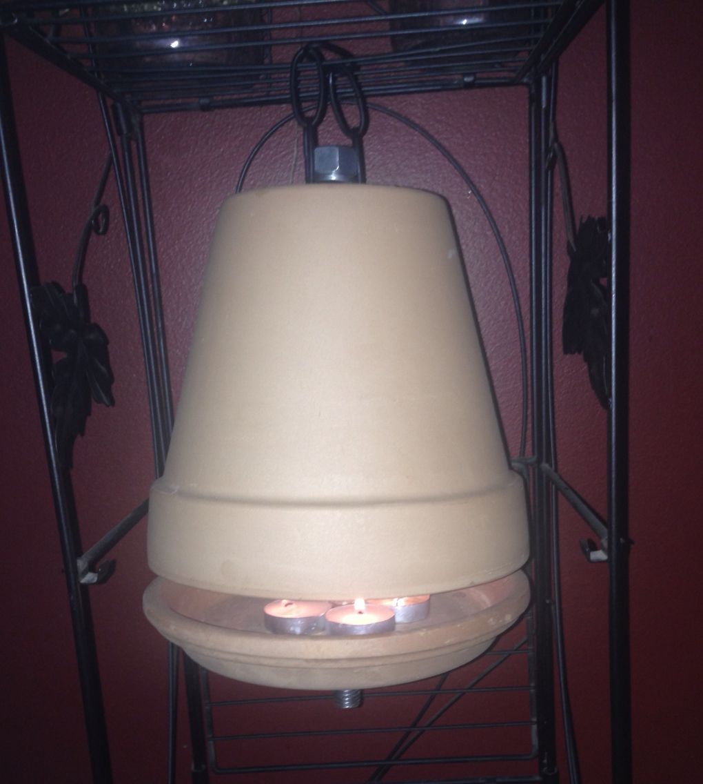 Clay Pot Candle Heater. Hanging From An Existing Plant