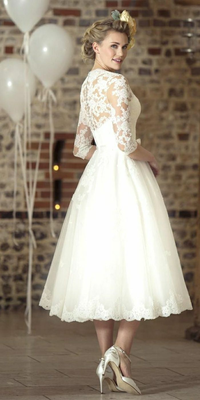 tea length dresses, blonde smiling bride looking back, wearing a ...