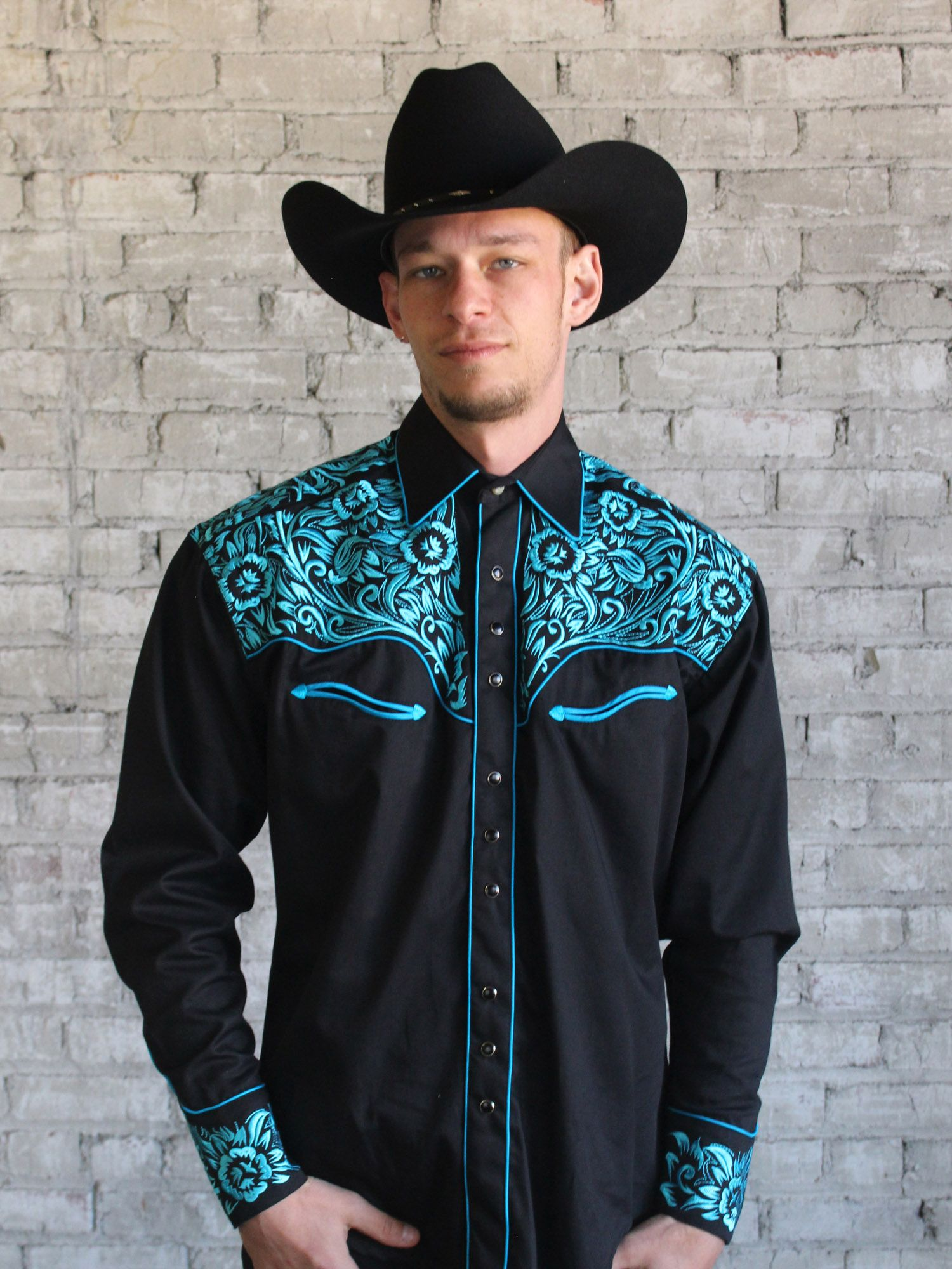 5cdcde55cbe6 This black western shirt with turquoise embroidery is inspired by saddle  leather tooling throughout: front, back and Shotgun cuffs.