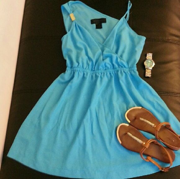 Kardashian Kollection blue spring dress Beautiful bright blue spring dress with a pop of gold on the right shoulder. Selling the dress only; accessories not included. Only wore a few times. Comes from pet free and smoke free home. Kardashian Kollection Dresses Midi