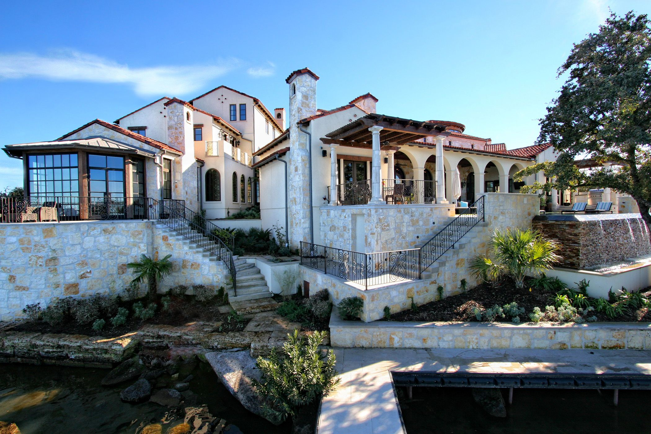 Horseshoe bay eclectic spanish lake house dockside view by for Idea homes austin