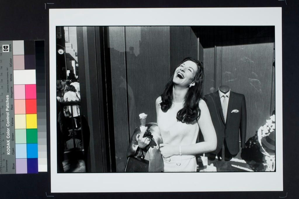 Woman With an Ice Cream Cone Laughing.  Garry Winogrand
