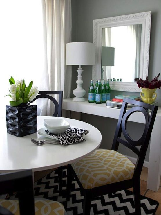 Black dining chairs with yellow imperial trellis fabric ...