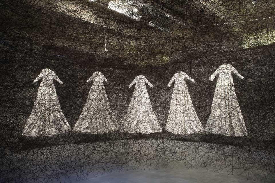 Chiharu Shiota (Japan) will construct a 9x9 metre web of interlacing black thread that will  feature a number of embedded white steps 'trapped' within the  calligraphic network. Visitors will be able to walk through the piece and  explore its spaces