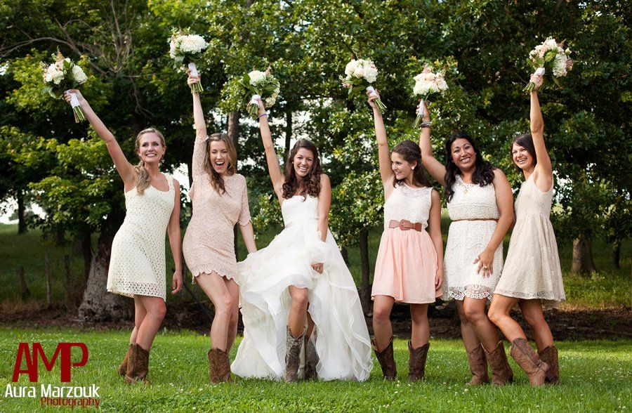 Bridesmaids pose in their lovely ivory lace bridesmaid dresses ...