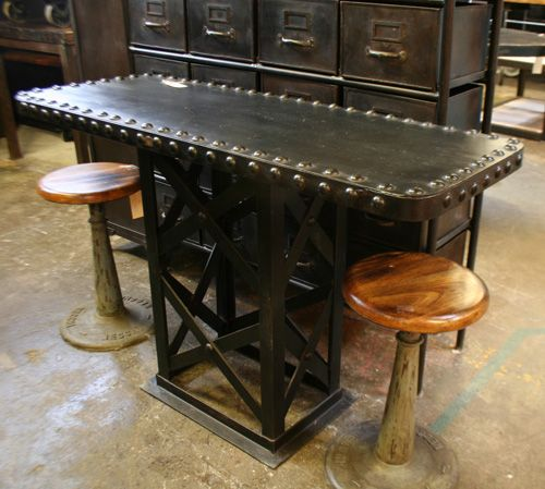 Christopher Bailey Of Industrial Chic Creates All Manner Of Manly Furniture.  This Steel Riveted Console Would Find A Nice Home In Any Man Cave.